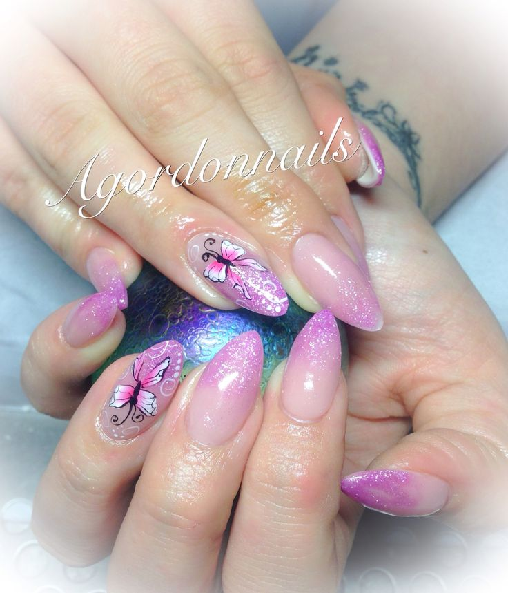 Sculpted almond nails and one stroke butterflies @agordonnails