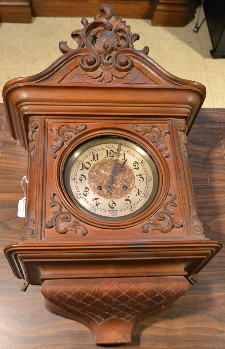 this beautiful old carved clock was one of many striking pieces at our weston estate sale - Feldstein Kaminsimse