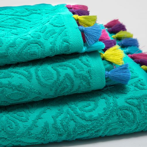 MULTICOLOURED JACQUARD TOWEL WITH POMPOMS