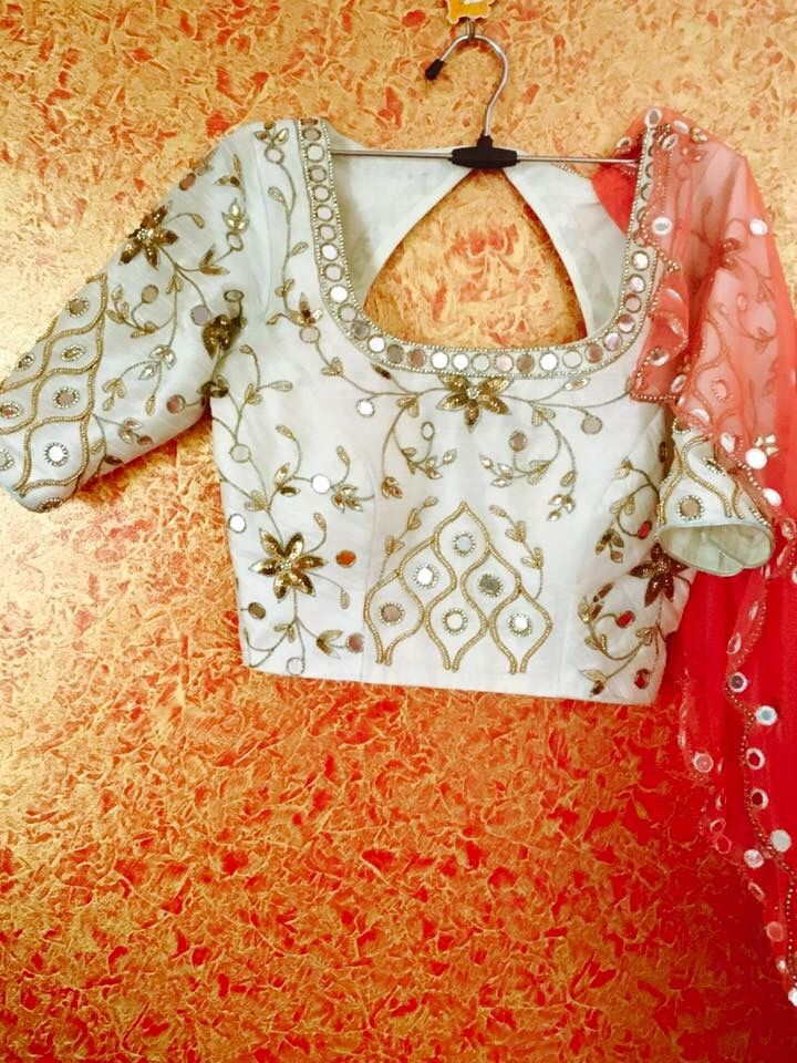 Pretty saree blouse with mirror work and embroidery. Indian fashion.