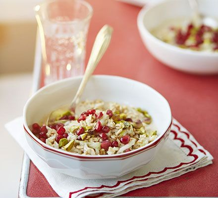 Pistachio nut & spiced apple bircher muesli. A balanced, filling breakfast bowl with oats and apple in low-fat yogurt, cinnamon and nutmeg and a nutty pomegranate topping