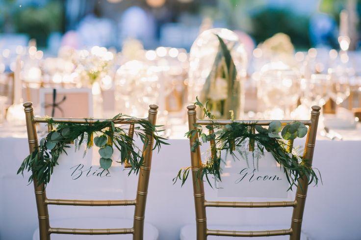 in their shoes. bride & groom handwritten signs.