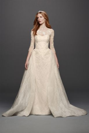 Cool An opulent tulle overskirt adds regal flair to this bonded lace ball gown wedding dress