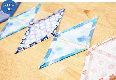 小さくなった子ども服で作れる!フラッグガーランドを作ろう! - 育児 ... ガーランドを並べ、ひもを布の中央に置く。