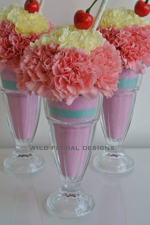Our 50s candy kitsch knickerbocker glory wedding centrepieces by Louise at Wild Floral Designs of Torquay. #flowers #icecream # candy #pastels #50s #kitsch
