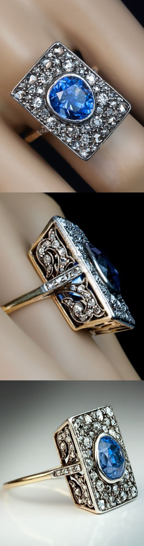 An Unusual Antique Sapphire and Diamond Engagement Ring circa 1900 The rectangular silver topped 18K gold ring is centered with an egg-shaped faceted natural unheated sapphire of an excellent even cornflower blue color. The sapphire is surrounded by old European, cushion and rose cut diamonds that are densely set in silver over gold. The renaissance style, floral openwork under gallery and shoulders of the ring are embellished with old rose cut diamonds.