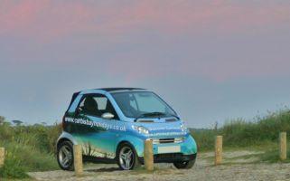 The cool Carbis Bay Holidays smart car enjoys a #Cornish sunset. #sky #smartcar
