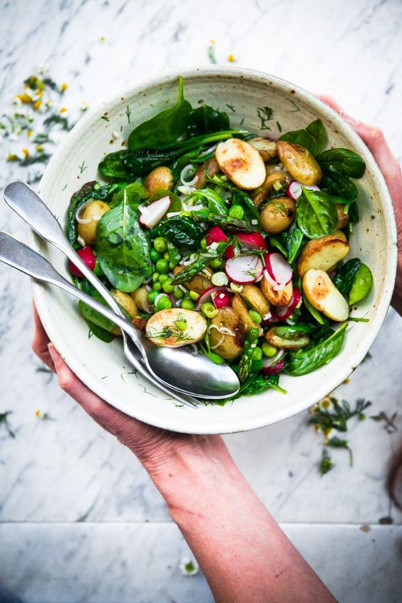 Vegan spring salad with roasted new potatoes, peas, asparagus and dill
