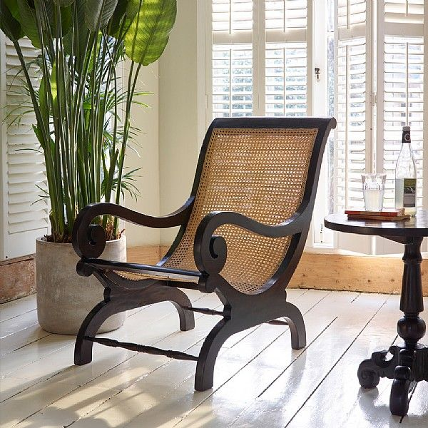 Lazy Teak Occasional Armchair. Our Keraton Carved lazy armchair has been hand carved from solid teak and hand woven rattan using traditional methods by skilled craftsmen in Indonesia. The rich hues, natural grain and lustrous rich brown finish offer a timeless design which is guaranteed to be a focal point in your home.