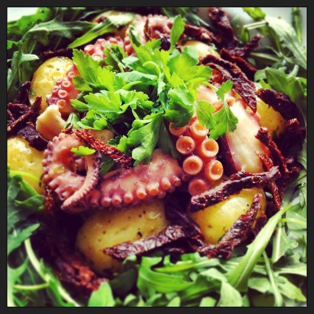 Octopus, new potatoes, rocket (arugula), sun dried tomatoes, parsley # ...