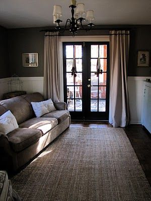 Cozy room, dark walls above bead board, bark painted doors.  Lots of white trim. Lovely. Love the curtain over the door