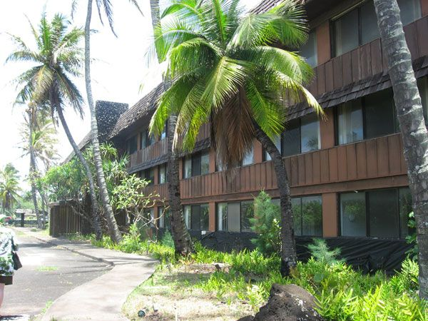 """Opened in 1953, Kauai's Coco Palms Hotel quickly gained fame for its blue lagoons, 2,000-tree coconut grove, and nightly torch lighting ceremony called """"The Call to Feast,"""" a tradition that resorts across Hawaii began to emulate. The property also played a starring role in the 1961 Elvis movie Blue Hawaii. The Coco Palms remained one of the island's most popular properties until 1992, Hurricane Iniki ravaged the place and caused damage so severe the hotel was forced to close indefinitely…"""