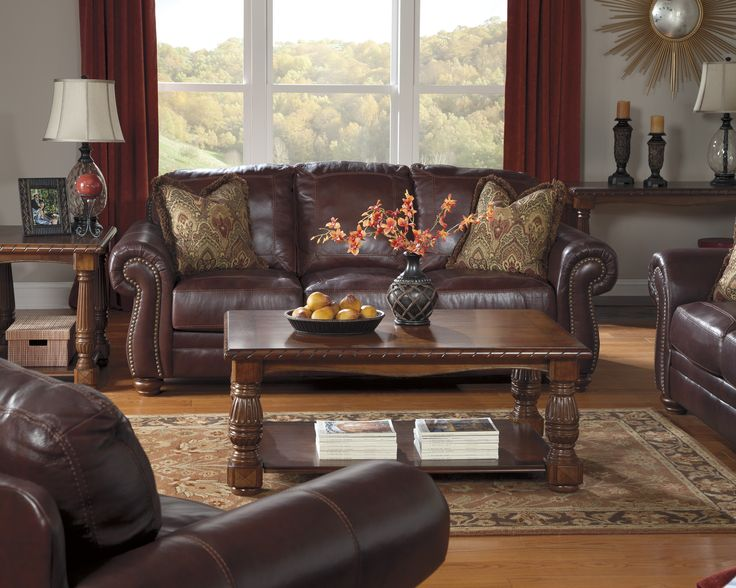 A Rich Dark Brown Leather Living Room Set.