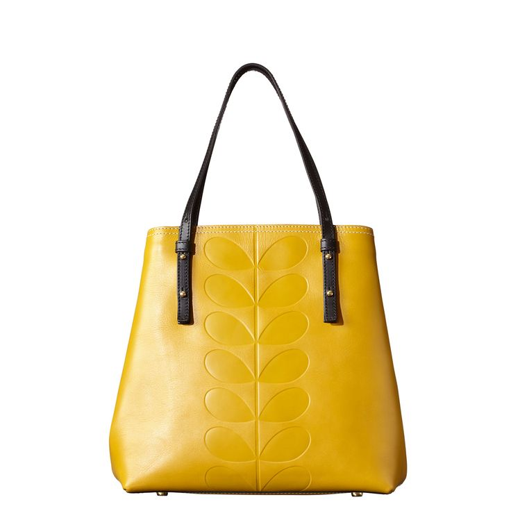 Orla Kiely: Structured leather bag, fully lined with embossed stem detail on front. Adjustable handles. Inside strap closure. Extendable side gusset opening feature. Inside details include signature linear stem jacquard lining, zip pocket, twin patch pocket and elastic key chain.