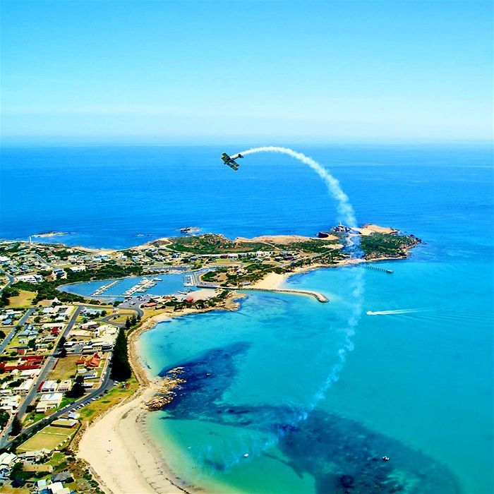Kristal captures a Tiger Moth zooming across the Robe coastline.