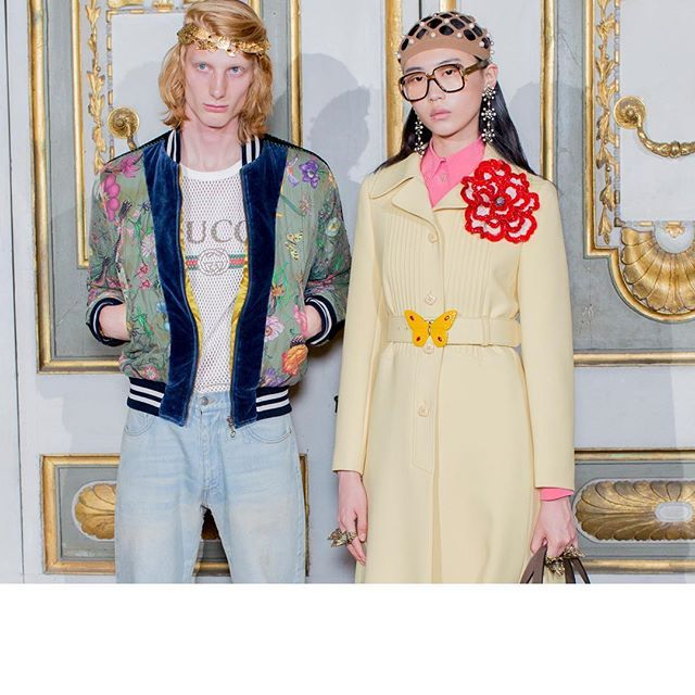 Behind the scenes at the #GucciCruise18 fashion show at the Palatine Gallery in Florence. A washed quilted silk bomber featuring the Flora Snake print, the Gucci logo T-shirt, vintage denim jeans, and a pin tuck crêpe coat, featuring a detachable belt with lacquered butterfly buckle and satin viscose skirt and net and pearl headpiece by #AlessandroMichele.