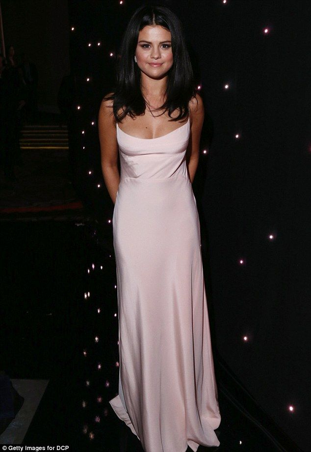 All white everything: Selena Gomez wowed in a silky spaghetti strap gown at the 19th Annual Hollywood Film Awards in Beverly Hills on Sunday