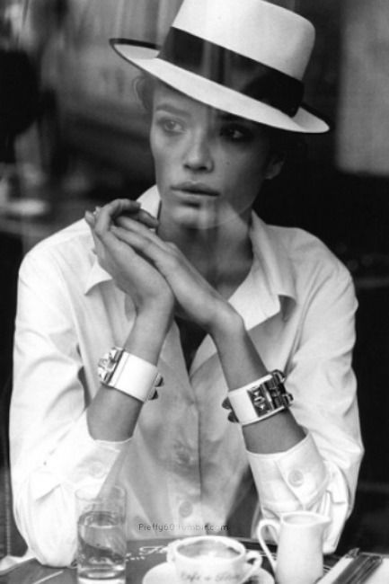 classic Hermès cuff and white button down. hair up, tucked under flat brim white hat.