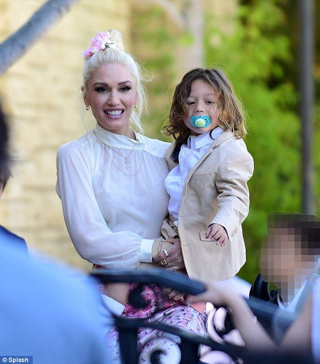 Gwen Stefani watches sons Kingston and Zuma's first holy communion #dailymail