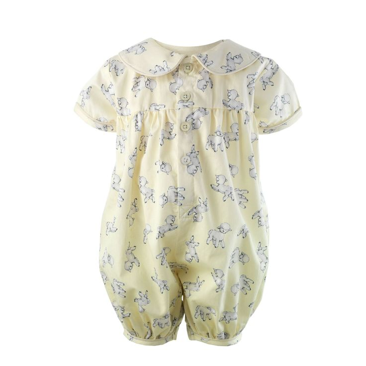 A Rachel Riley classic for baby! Soft lightweight woven cotton babysuit with a sweet lamb print. Pretty gathers at yoke, sweet peter-pan collar and trimmed with a matching piping . Pearl effect buttons to fasten at front and inner leg opening.   Print exclusive to Rachel Riley.