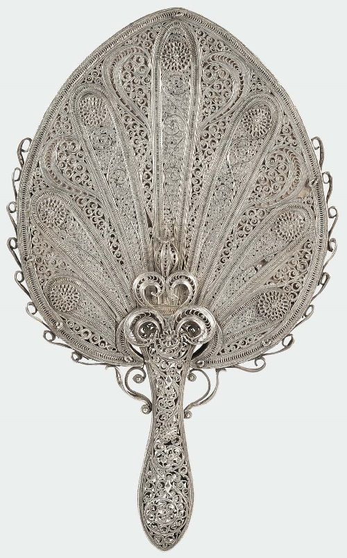 Silver filigree mirror with peacock feathers motives, India 19th century