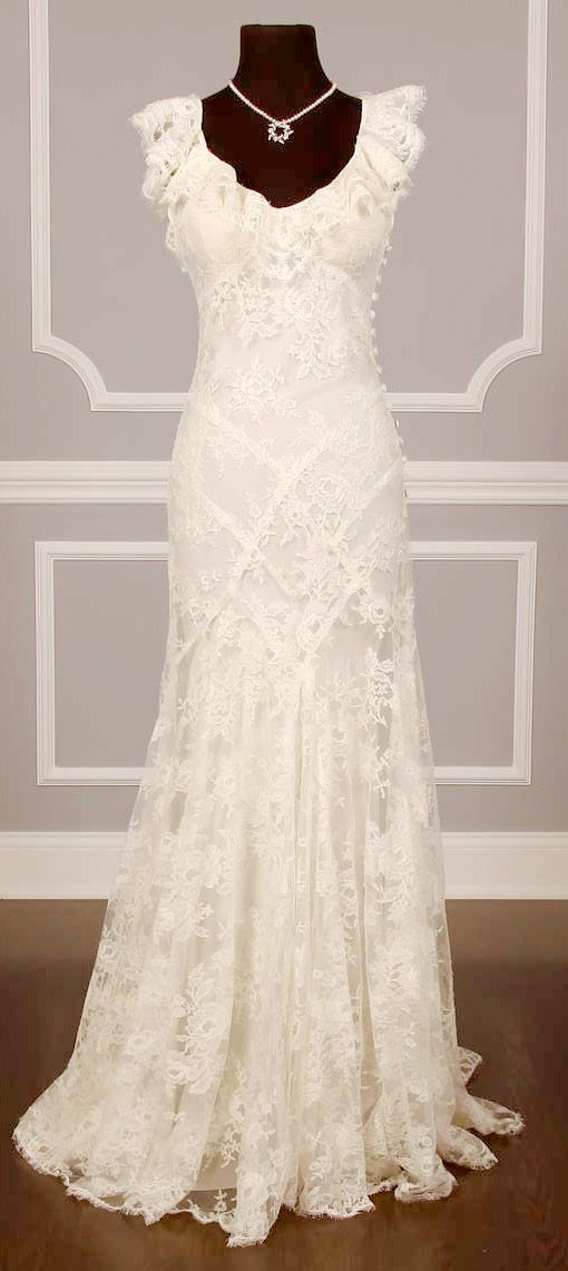 Love the way the fabric falls at the bottom of this vintage chantilly lace wedding dress...
