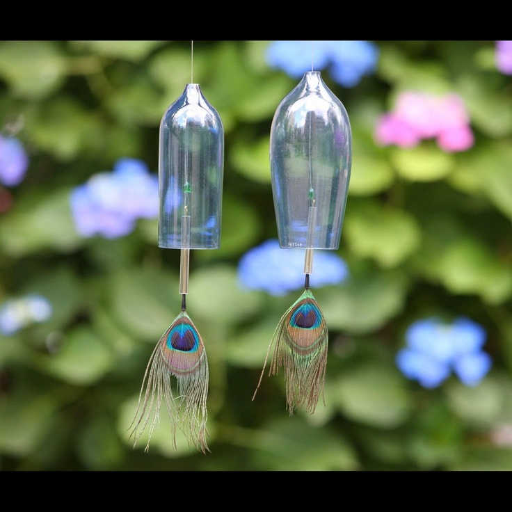 glass wind-bell with peacock feather