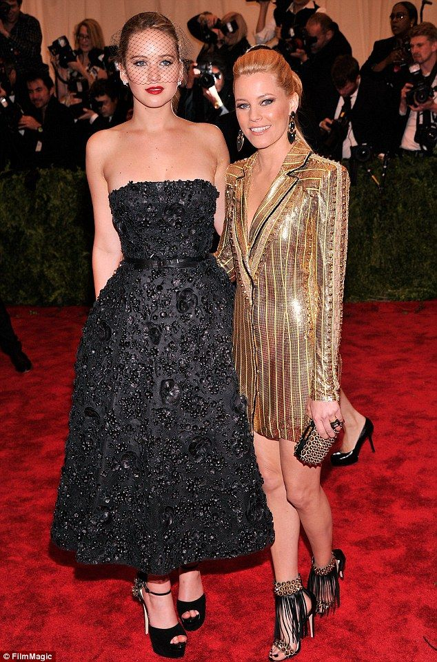 Different look: Jennifer, seen here with Elizabeth banks dressed conservatively in comparison to other celebrities