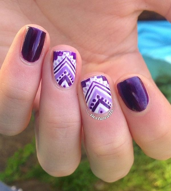 Tribal inspired Purple nail art design. Take up your while and purple polish and combine them to create this stunning and interesting tribal designs.