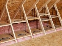 Attic storage. Shelves are placed in between the attic trusses to hold plastic tubs.