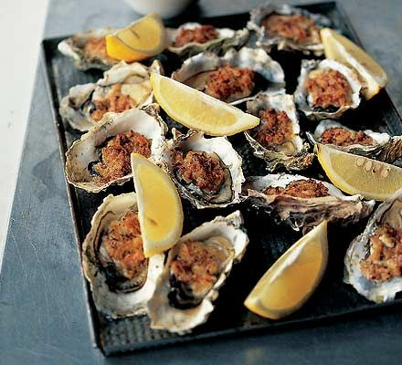 Oysters Kilpatrick - a bacon and brioche crumb, the underside seasoned with tabasco and worcestershire sauce, grilled