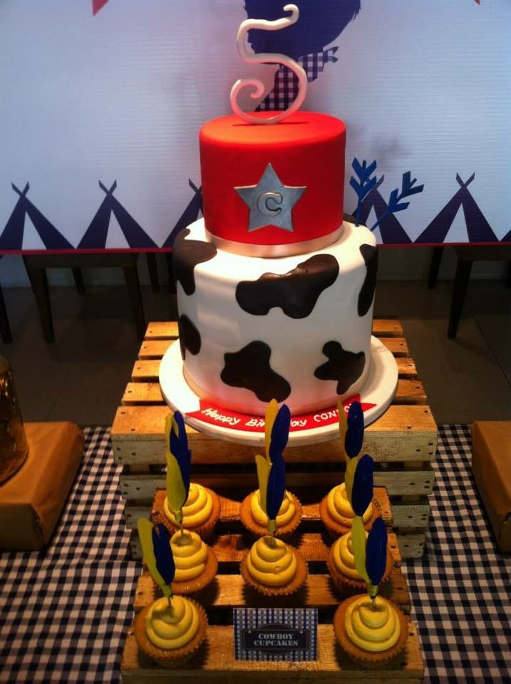 Birthday cake and cowboy cupcakes with hand made feather decorations