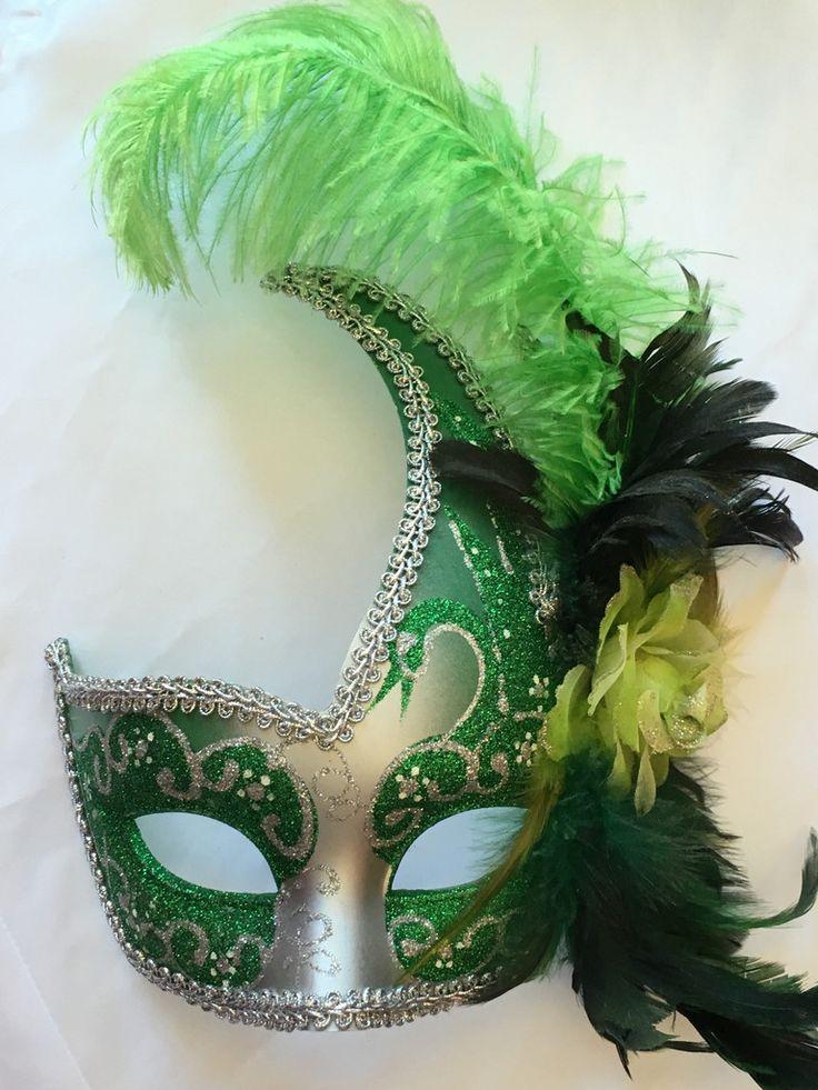 Black 3/4 face Mardi Gras mask with black ribbon ties.
