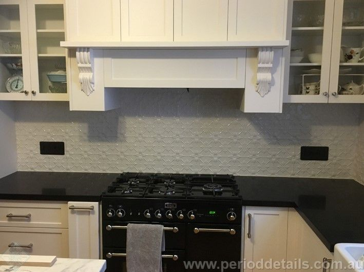 Interpon Mercury Silver powdercoat has been used on the Original pattern pressed metal for this kitchen splashback.  The soft silver colour provides a wonderful contrast between the white cupboards and black countertops. For sizing and pricing go to:  www.perioddetails.com.au