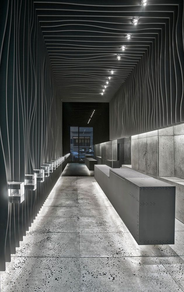 Feature wall - slats D Jewelry / Vaillo + Irigaray | Wall Candy. Fantastic effect of light giving a sense of floating furniture