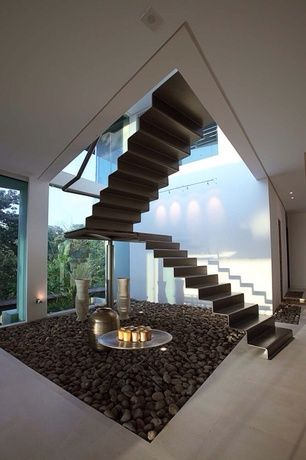 Modern Staircase with Ecostudio Architects Triangulo House Custom Accordion Stairs, flush light, High ceiling