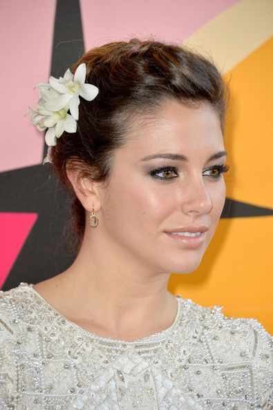 Blanca Suarez Braided Updo - Bianca Suarez chose a braided updo accentuated with a white flower for her soft and romantic look on the red carpet.
