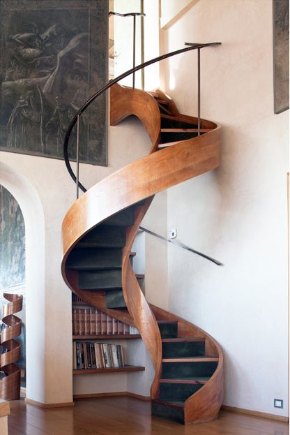 Spiral wood staircase adds elegance to this minimalistic room; see the repeated spiral form to the left in the next room!?