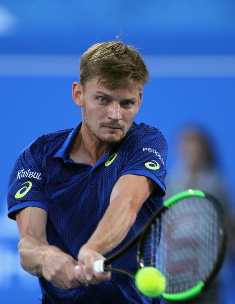 David Goffin Photos Photos - David Goffin of Belgium in action against Andy Murray of Great Britain during day two of the Mubadala World Tennis Championship at Zayed Sport City on December 30, 2016 in Abu Dhabi, United Arab Emirates. - Mubadala World Tennis Championship - Day Two