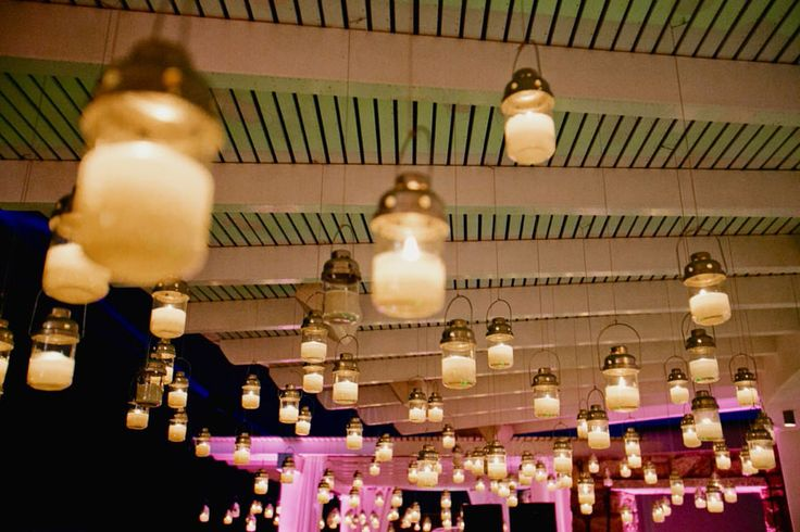 Hanging lanterns on pergolas to create a fairy tale setting for your wedding reception.