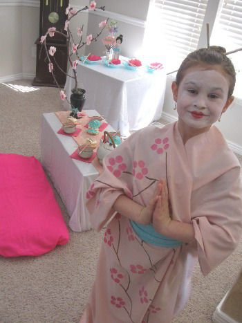 How to Throw a Japanese Birthday Party: Fun, easy ideas: tissue paper blossoms, tree branch centrepiece, box & cushions for Asian style seating, DIY kimono, Geisha make-up activity, with Geisha photo shoot for guests, & origami art activity / TheGalaGals