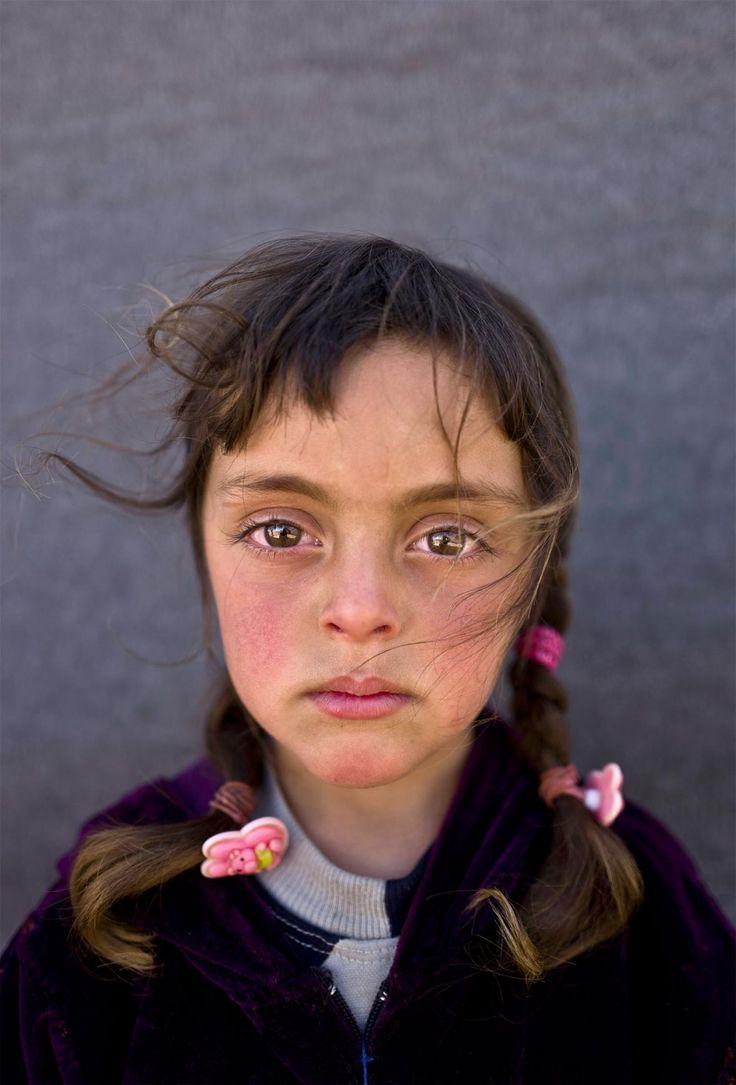 Syrian refugie girl y Mohammed Muheissen