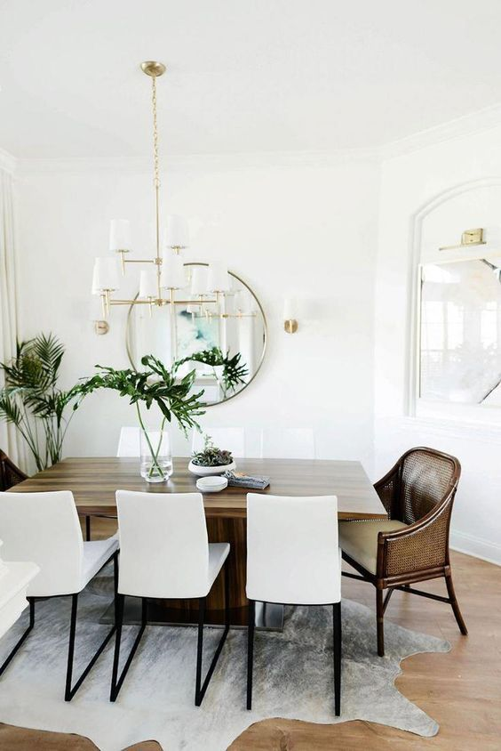 Dining Table With Cowhide Rug And Wood Table With Gold Chandelier Diningro Interior Design Dining Room Scandinavian Dining Room White Dining Room