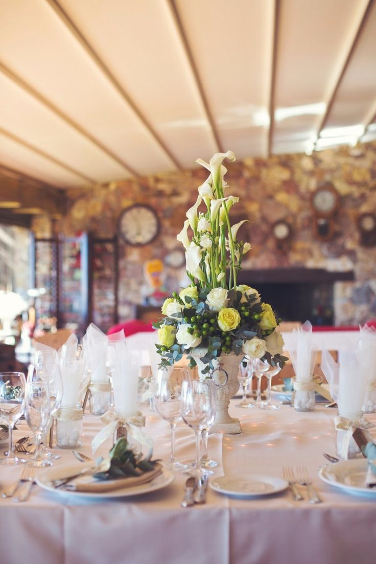 Classic & elegant wedding centerpiece and table arrangement at Ktima Laas, Attika- Greece. Wedding Styling by Style Concept, captured by Fiorello photography. See more here: http://www.StyleConcept.gr/en