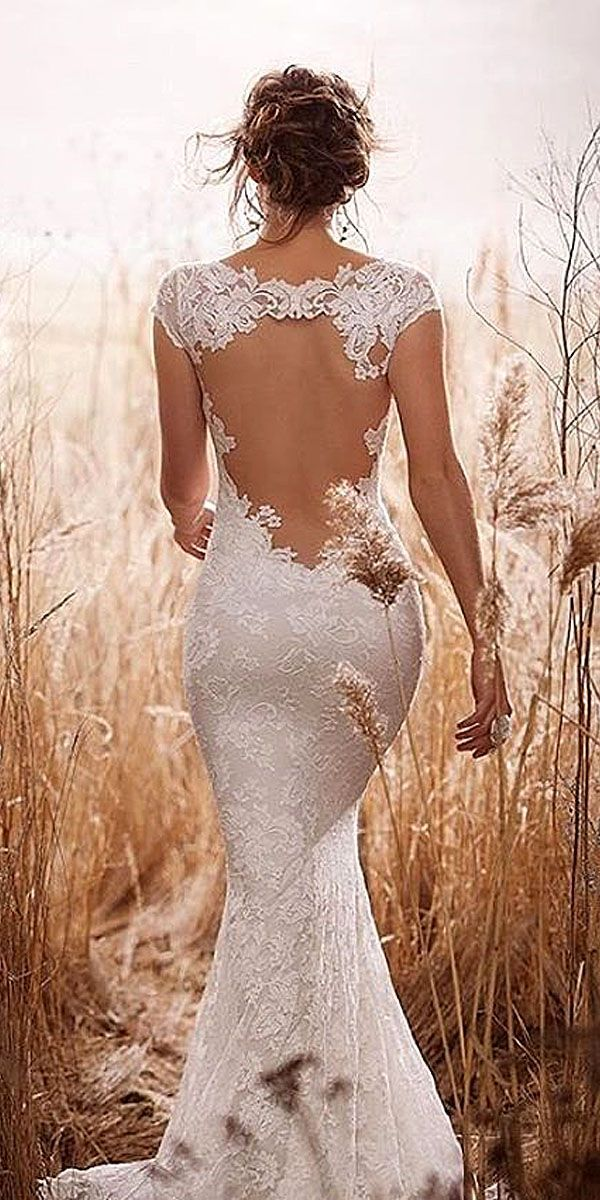 Lace dress with key hole peephole back and floral detailing. rustic style wedding dresses 1