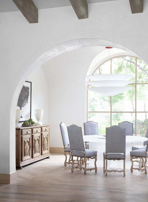 Light/white/airy, the round dining table and upholstered chairs.