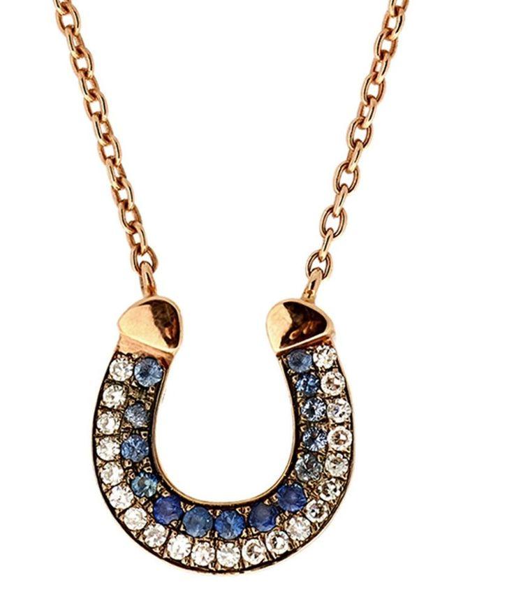 Selim Mouzannar's sapphire ad diamond horseshoe pendant