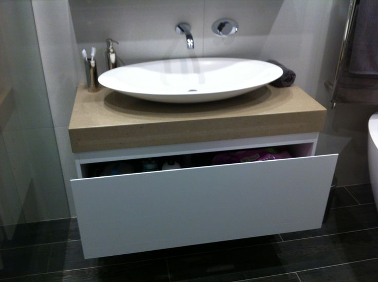 Vanity with one large drawer for storage Wall tap and spout