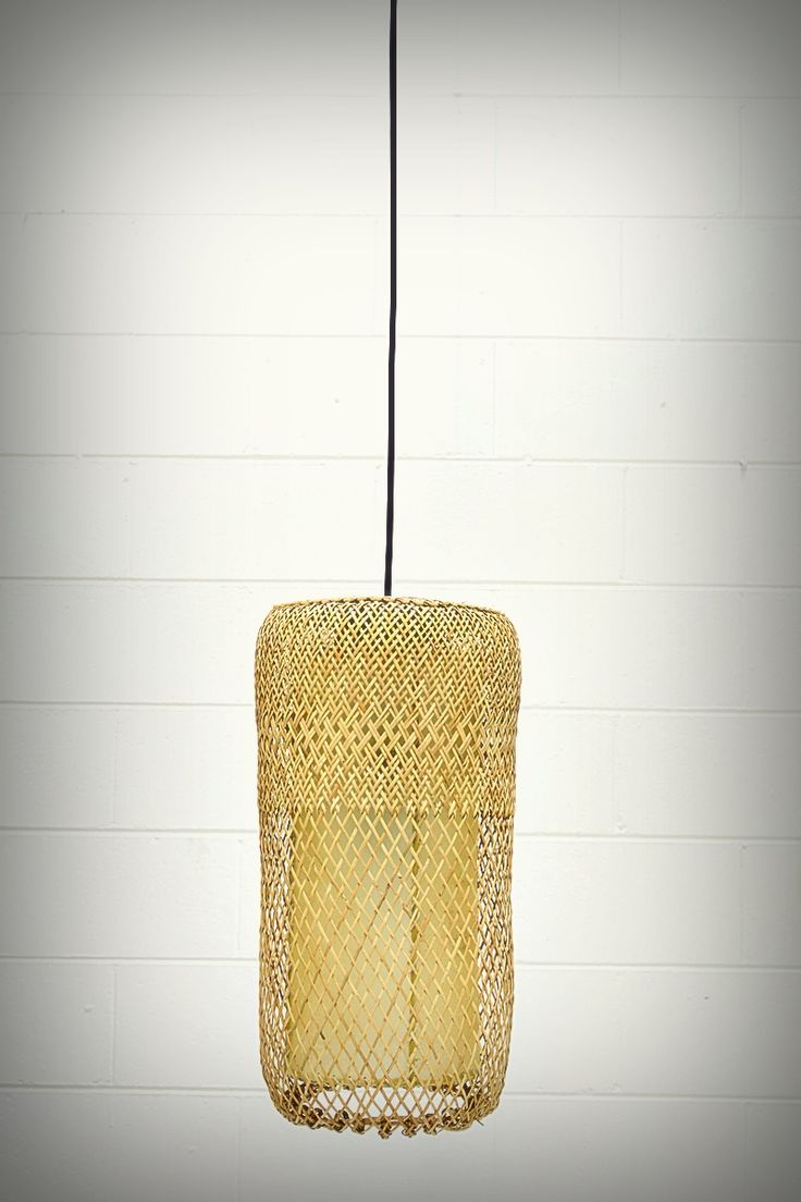 Lovely natural rattan pendant light with leather insert. Creates an earthy balance with the mix of textures. 270mm wide and 480mm high, a nice minimal option for over the kitchen bench