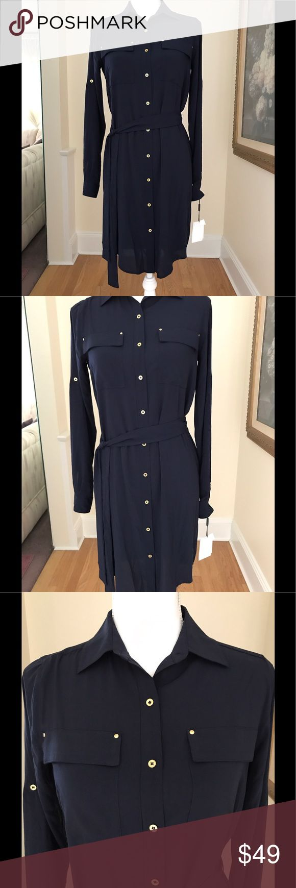 "Calvin Klein NWT Navy Blue Belted Shirt Dress Sz 2 Calvin Klein New With Tags Belted Shirt Dress In Twilight( Navy Blue). Size 2. The Dress Features Gold Buttons And Two Front Pockets. The Sleeves Are Adjustable Allowing A Long Length Or A Half Sleeve. An Extra Button Is Included. 35"" Shoulder To Hem. 15"" Shoulder To Shoulder. 17"" Underarm To Underarm. 25"" Shoulder To Cuff. All Measurements Are Approximate. 97% Polyester, 3% Spandex. Calvin Klein Dresses Midi"